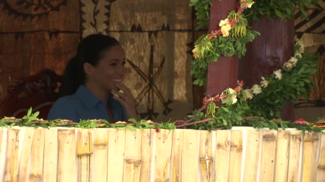 duke and duchess of sussex get the giggles as they watch performance of the mosquito song during visit to tupou college in tonga - meghan duchess of sussex stock videos and b-roll footage