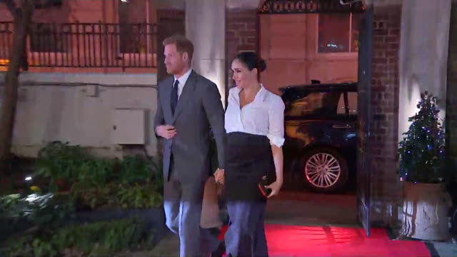 Duke and Duchess of Sussex hold hands as they arrive at the Endeavour Fund Awards at Draper's Hall in London