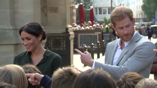 Duke and Duchess of Sussex joking with children on their visit to Brighton