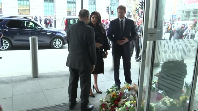 Duke and Duchess of Sussex look at floral tributes for Christchurch mosque terror attack victims as they leave the New Zealand High Commission in...