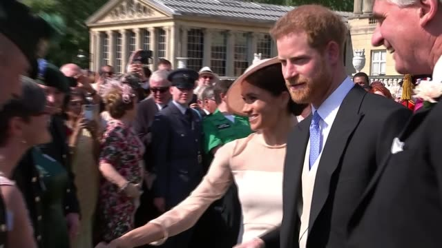 duke and duchess of sussex make first public appearance as married couple at prince charles's 70th birthday garden party; england: london: buckingham... - wedding ring stock videos & royalty-free footage
