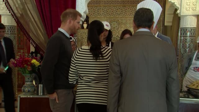 Duke and Duchess of Sussex taste Moroccan food and meet chef Moha Fedal MOROCCO Rabat Villa des Ambassadedurs PHOTOGRAPHY*** Prince Harry Duke of...