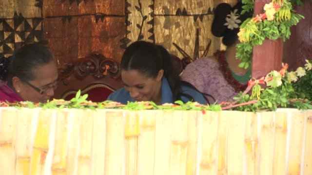 Tupou College visit TONGA Tongatapu Toloa Tupou College Prince Harry Duke of Sussex along / children seated / Meghan Duchess of Sussex seated with...