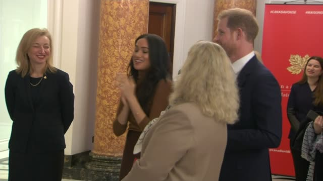 duke and duchess of sussex visit canada house england london canada house int gv embassy staff gathered at bottom of stairs tilt up embassy staff... - canada house stock videos and b-roll footage