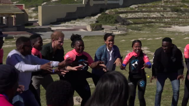 duke and duchess of sussex visit mental health charity waves for change at monwabisi beach in cape town and take part in team building exercise on... - harry meghan tour stock videos and b-roll footage