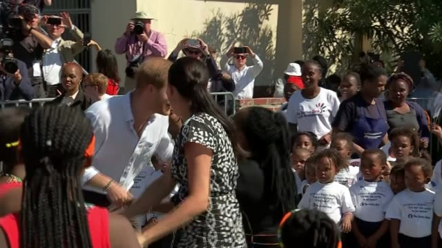 duke and duchess of sussex visit nyanga township south africa cape town nyanga township ext prince harry duke of sussex and meghan duchess of sussex... - dancing stock videos & royalty-free footage