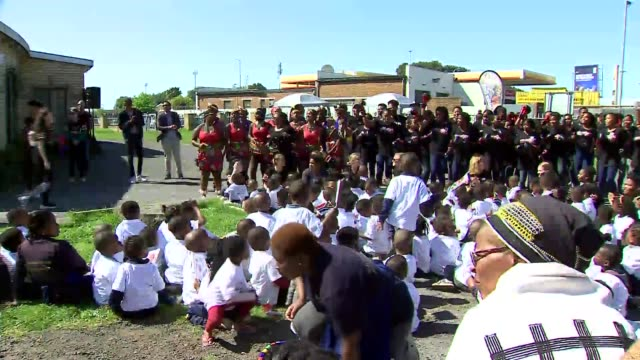 duke and duchess of sussex visit the justice desk in nyanga township south africa cape town nyanga township ext **picture quality as incoming** group... - duke and duchess of sussex stock videos and b-roll footage