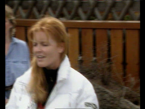 duke and duchess of york divorce; switzerland: verbier: ext sarah, duchess of york towards out of chalet verbier pull out tms duchess facing bv press... - サラ ファーガソン点の映像素材/bロール