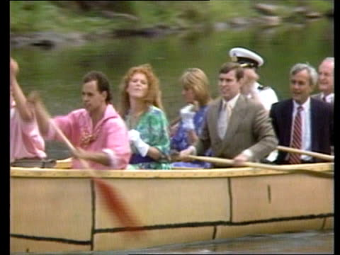 duke and duchess of york in canada special report kaminstiquia fort william river canoe with several people in it paddled towards tbv canoe away ms... - 公爵点の映像素材/bロール