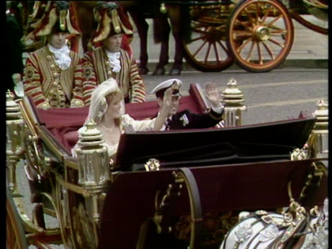 duke and duchess of york in horse drawn carriage wave to crowd as they leave westminster abbey royal wedding of prince andrew and sarah ferguson 23... - duchess of york stock videos & royalty-free footage
