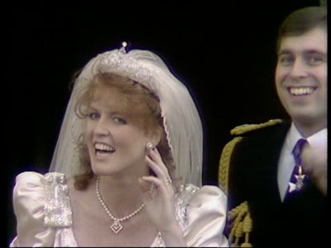 Duke and Duchess of York on balcony laugh and point at crowd and then kiss Royal Wedding of Prince Andrew and Sarah Ferguson 23 Jul 86