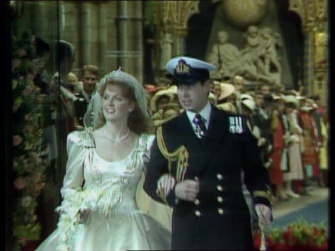 duke and duchess of york - remarriage speculation; westminster abbey: ext duke and duchess of york leaving abbey after wedding pull out london: duke... - ヨーク公爵夫人点の映像素材/bロール