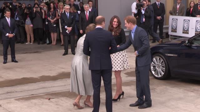 duke & duchess of cambridge & prince harry arrive at leavesden studios on april 26, 2013 in watford, england - 白のドレス点の映像素材/bロール