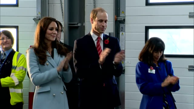 stockvideo's en b-roll-footage met duke & duchess of cambridge visit valero pembroke refinery; william and kate standing in hall listening to speeches and recitals / performances being... - pembroke