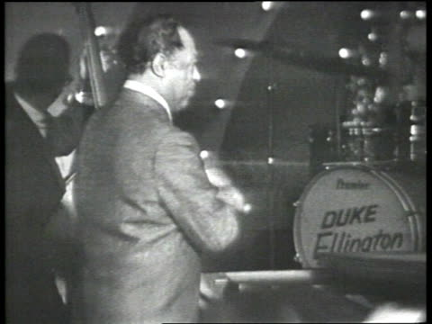 """duke ellington and adult african american male band members continue performing """"tutti for cootie""""; adult caucasian male and female couples dancing.... - jazz stock videos & royalty-free footage"""