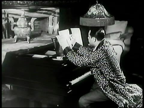 stockvideo's en b-roll-footage met duke ellington sheet music jazz composer pianist bandleader duke ellington sitting at piano in home composing music duke playing piano sot jazz... - 1899