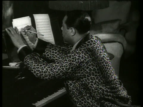 b/w duke ellington writing music playing piano in home - musician stock videos and b-roll footage
