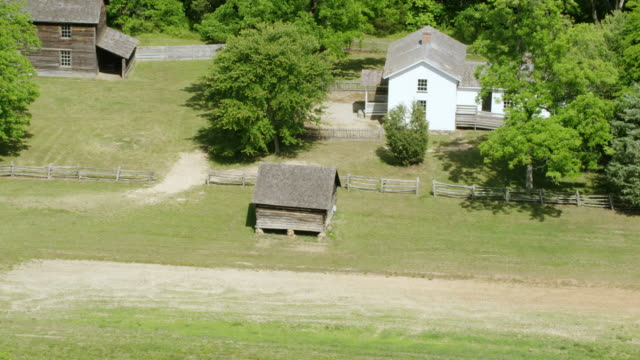 WS AERIAL POV Duke Homestead with Tobacco Factory surrounded by tree / Durham, North Carolina, United States