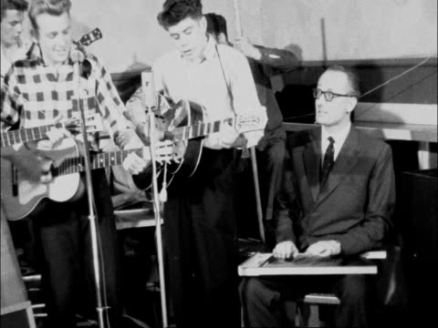 duke of bedford plays in skiffle group; england: bedfordshire: woburn abbey: int **music heard sot** john ian robert russell plays in group - offbeat stock videos & royalty-free footage