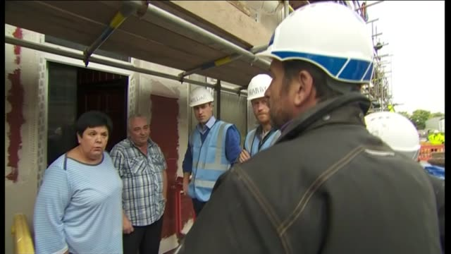 duke of cambridge and prince harry visit bbc's diy sos team in manchester england manchester ext construction workers working on site / prince... - sos stock videos and b-roll footage