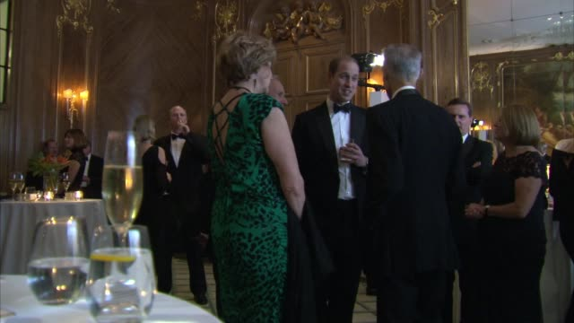 duke of cambridge at tusk conservation awards england london claridge's photography*** duke of cambridge chats with guests in evening wear / deborah... - evening wear stock videos & royalty-free footage