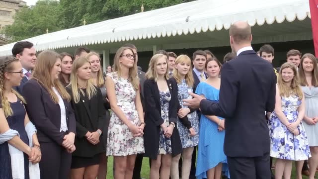 Duke of Cambridge meets young people at a Duke of Edinburgh awards event at Buckingham Palace