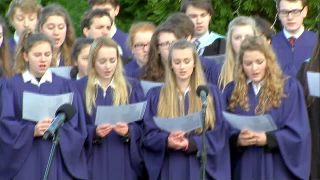 duke of cambridge unveils memorial to ww1 christmas truce; choir singing silent night sot / memorial - choir stock videos & royalty-free footage