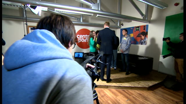 duke of cambridge visits centrepoint homeless charity in bradford; william chatting to young man / william shaking hands with young people in media... - clapperboard stock videos & royalty-free footage