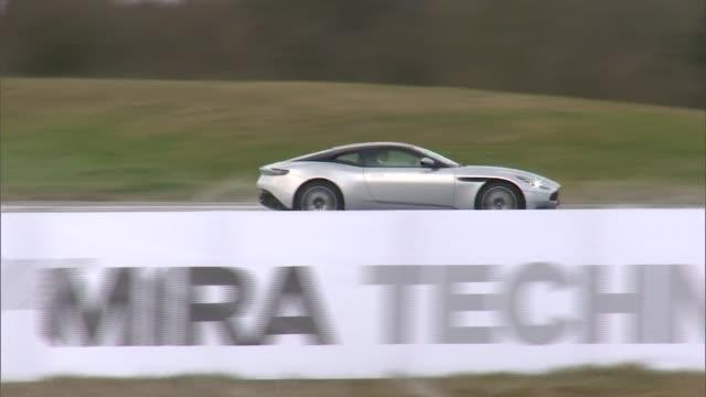 Duke of Cambridge visits MIRA Technology Park Wet weather handling test track / Aston Martin going round test track / Prince William Duke of...