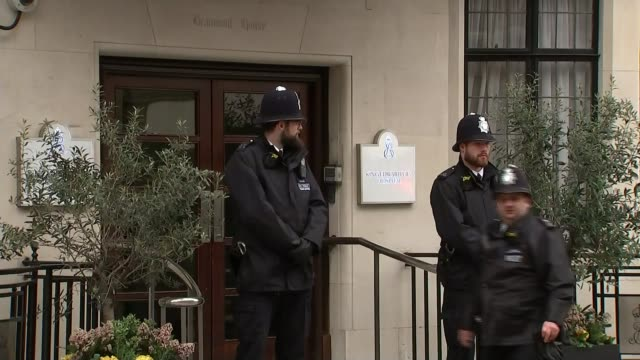 duke of edinburgh admitted to hospital as a 'precautionary measure'; england: london: king edward vii hospital: ext gv two police officers guarding... - blinds stock videos & royalty-free footage