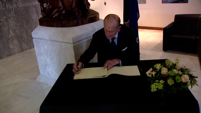 duke of edinburgh and prince of wales sign book of condolence for new zealand earthquake england london haymarket new zealand house int gvs prince... - official car stock videos & royalty-free footage