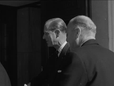 duke of edinburgh at institute of electrical engineers; england: london: savoy place: ext prince philip, duke of edinburgh out of car and up steps:... - itv evening bulletin stock videos & royalty-free footage