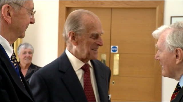 Duke of Edinburgh attends medal ceremony at Royal Society of Edinburgh Duke of Edinburgh chatting with others in reception area