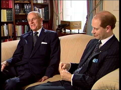 vídeos y material grabado en eventos de stock de duke of edinburgh awards 50 years old london buckingham palace int prince philip duke of edinburgh interview sot we had a girl who wanted to learn to... - palace room