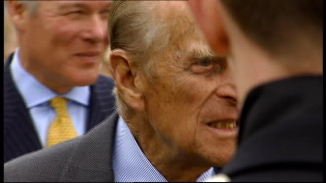 duke of edinburgh awards event **music heard intermittently sot** various of philip chatting to people in line up / philip chatting to girl in... - award stock videos & royalty-free footage