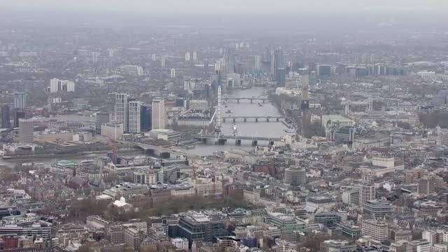 duke of edinburgh death: air views of london; england: london: ext air view / aerial central london including the london eye, buckingham palace,... - hungerford bridge stock videos & royalty-free footage