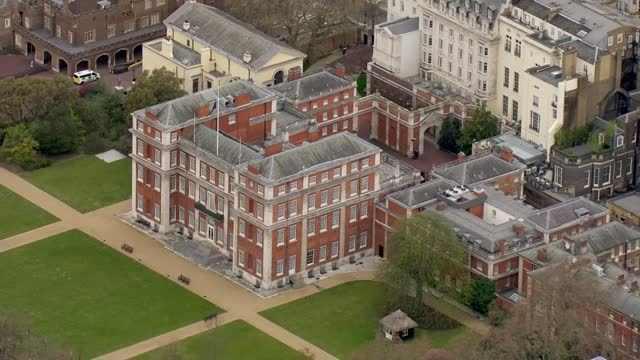 duke of edinburgh death: air views of london; england: london: ext air view / aerial buckingham palace / clarence house with union jack flag flown at... - aerial view stock videos & royalty-free footage