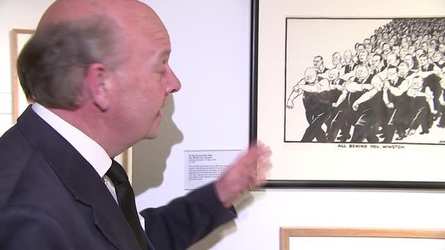 duke of edinburgh death: cartoon museum pays tribute; england: london: the cartoon museum: int oliver preston interview sot cutaway cartoon of prince... - puppet stock videos & royalty-free footage