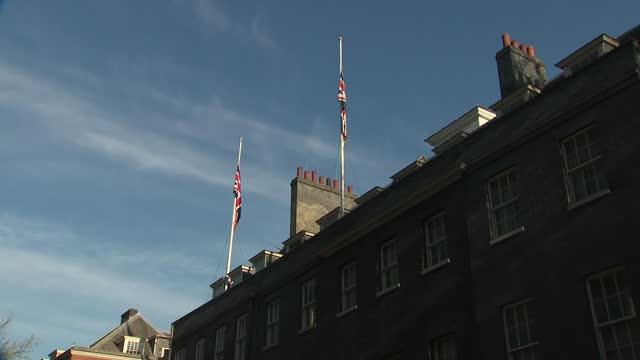 duke of edinburgh death: downing street flags at half mast; england: london: westminster: downing street: ext gvs 10 downing street with union jack... - politics stock-videos und b-roll-filmmaterial