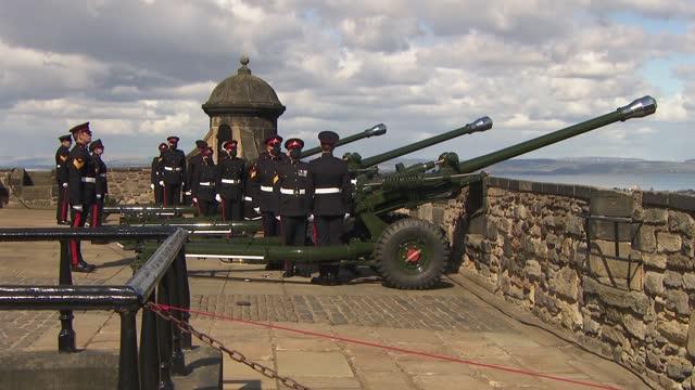 duke of edinburgh death: edinburgh castle gun salute; scotland: edinburgh: edinburgh castle: ext various of soldiers from the 105th regiment royal... - fortress stock videos & royalty-free footage