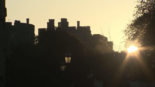 duke of edinburgh death: funeral preparations continue; england: berkshire: windsor castle: ext / dusk sun setting over windsor castle sunset behind... - sunset stock videos & royalty-free footage
