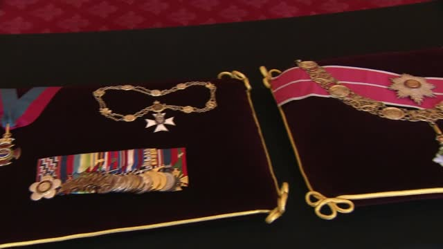duke of edinburgh death: insignia being prepared for funeral; england: berkshire: windsor: int various close shots of insignia laid out ion cushions... - war and conflict stock-videos und b-roll-filmmaterial