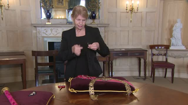 duke of edinburgh death: insignia being prepared for funeral; england: berkshire: windsor: int various close shots of of seamstress sewing insignia... - sewing stock videos & royalty-free footage