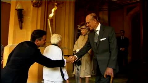 duke of edinburgh leaves hospital following bladder infection; lib england: berkshire: windsor castle: lord coe and torch bearer arriving at castle... - blase harnapparat stock-videos und b-roll-filmmaterial