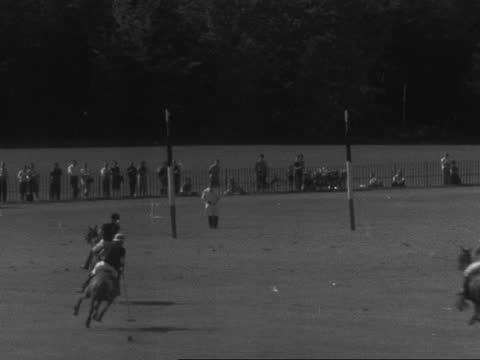 duke of edinburgh plays polo; england: berkshire: windsor: ext prince philip, duke of edinburgh rides: ditto - crowd in f/g: crowd: duke in play: lms... - southwest usa stock videos & royalty-free footage