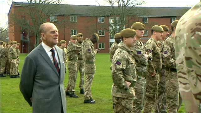 duke of edinburgh visits lille barracks england hampshire aldershot ext prince philip and others along towards football match / duke watching... - lille stock videos & royalty-free footage