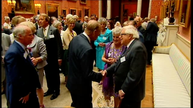 duke of edinburgh's 90th birthday england england buckingham palace photography** prince philip the duke of edinburgh stands smiling as guests at... - 100th anniversary stock videos & royalty-free footage