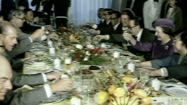 duke of edinburgh's 90th birthday tx kunming int queen elizabeth and prince philip seated at banquet drinking toast - 90th birthday stock videos and b-roll footage