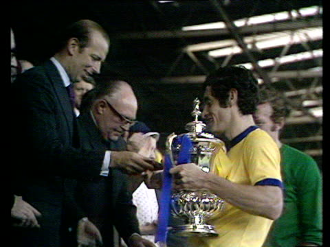 Duke of Kent presents trophy and winner's medal to Arsenal captain Frank McLintock who holds FA Cup aloft in triumph Arsenal vs Liverpool 1971 FA Cup...
