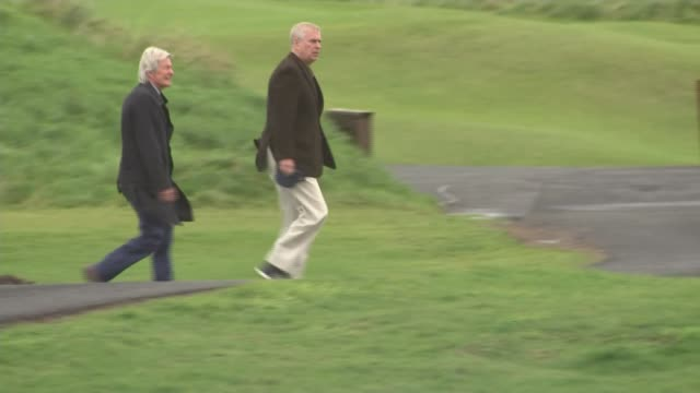 duke of york sighted with celebrity media lawyer paul tweed northern ireland portrush royal portrush golf course ext prince andrew duke of york along... - ヨーク公 アンドルー王子点の映像素材/bロール